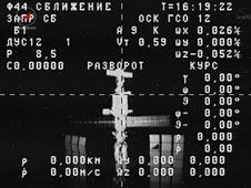 A video camera on the departing ISS<br /> Progress 48 captured this view of the<br /> Russian segment of the International<br /> Space Station.<br /> Credit: NASA TV